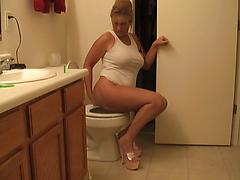Mature Blonde Pulls Down Panties And Bends Over For Enema