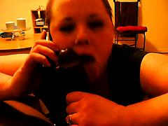 Cheating slut sucks cock while on the phone to her BF