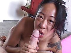 Asian Woman Slurps On Cock Then Takes It In Wet Pussy