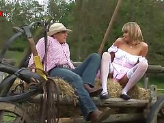 Dirty-minded milf in white stockings fucks outdoors with a farmer
